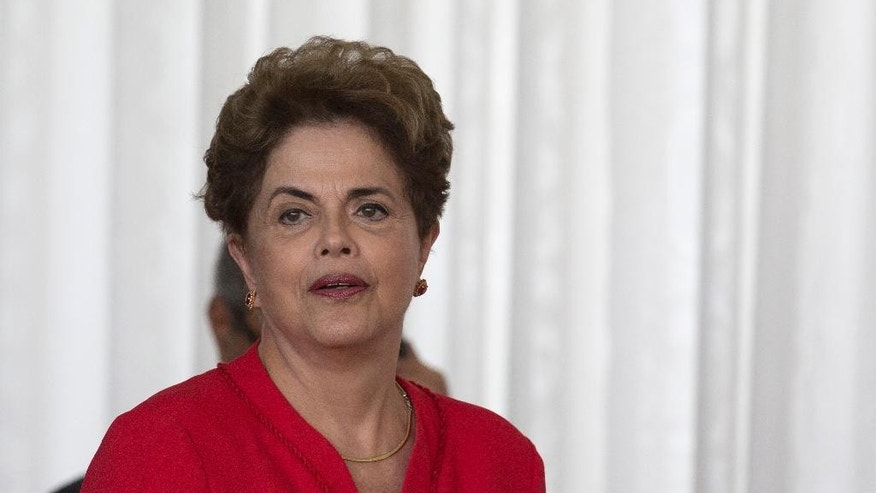 "Brazil's ousted President Dilma Rousseff arrives for her speech at the official residence of the president, Alvorada Palace in Brasilia, Brazil, Wednesday, Aug. 31, 2016. In her first remarks after being ousted as Brazil's president, Rousseff is vowing to form a strong opposition front against the new government. saying, ""They think that they beat us, but they are wrong."" she said. (AP Photo/Leo Correa)"