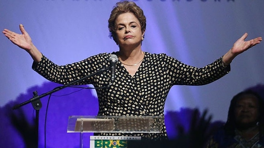 BRASILIA, BRAZIL - MAY 10: Embattled Brazilian President Dilma Rousseff speaks at a women's conference on May 10, 2016 in Brasilia, Brazil. Rousseff is facing an impeachment vote in the Senate tomorrow that could force her to step down from the presidency for 180 days and face trial.  (Photo by Mario Tama/Getty Images)