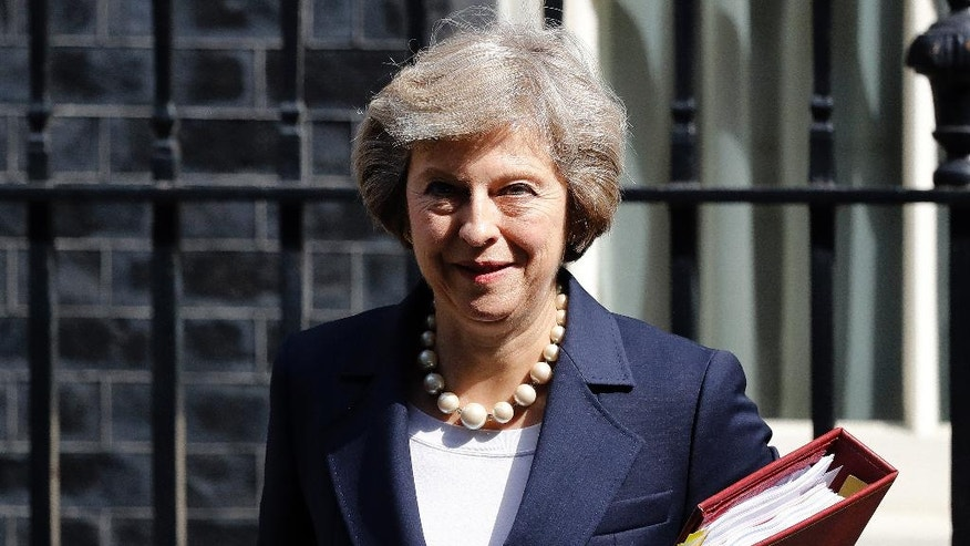 FILE- In this Wednesday, July 20, 2016 Britain's Prime Minister Theresa May leaves 10 Downing street for Prime Ministers Questions at the House of Parliament in London. Officials at May's Downing Street office say May is bringing her Cabinet together at her rural retreat, next Wednesday Aug. 31, 2016, to plot Britain's first steps on leaving the European Union. (AP Photo/Frank Augstein)