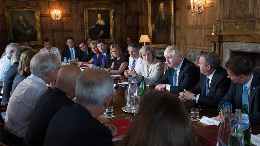 Britain's Prime Minister Theresa May, center right, holds a cabinet meeting at her country retreat Chequers in Wendover, England, Wednesday Aug. 31, 2016. May is discussing specific plans for the country to leave the European Union in a session meant to underscore Conservative party unity. (Stefan Rousseau/PA via AP)