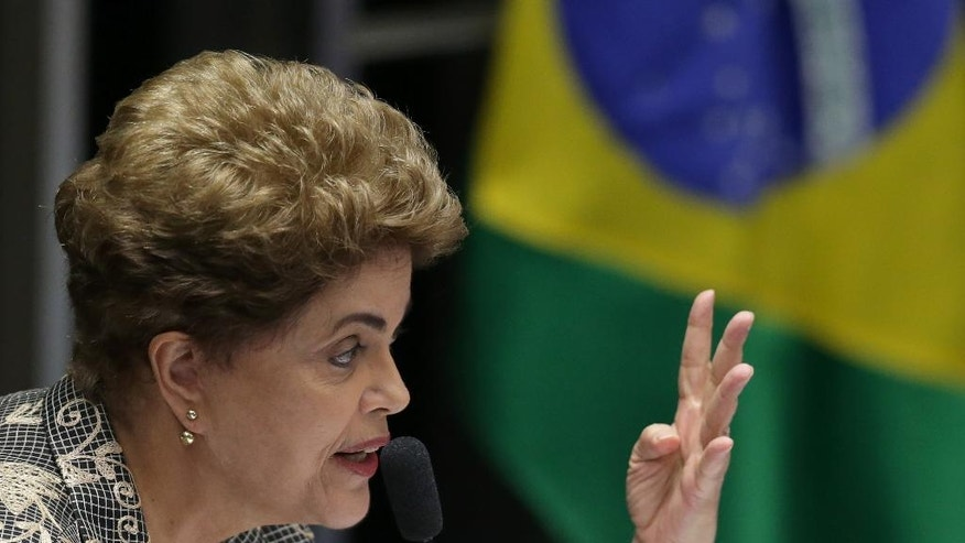 Brazil's suspended President Dilma Rousseff speaks at her own impeachment trial, in Brasilia, Brazil, Monday, Aug. 29, 2016. Rousseff reminded senators that she was re-elected in 2014 by 54 million voters. She says that at every moment she has followed the constitution and done what was best for the country. (AP Photo/Eraldo Peres)