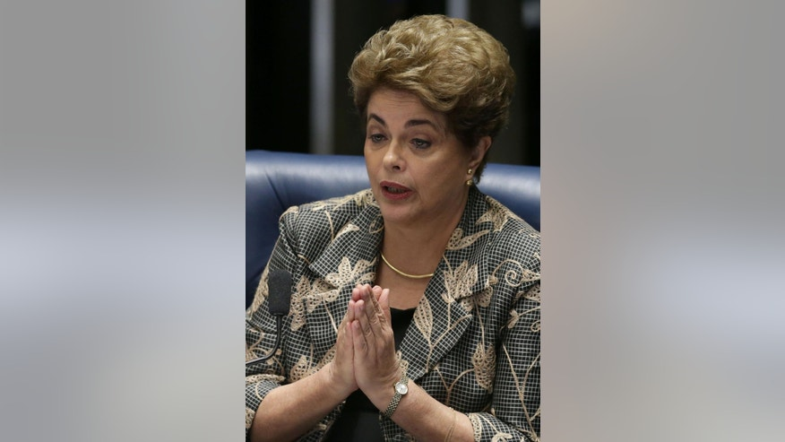 "Brazil's suspended President Dilma Rousseff speaks at her impeachment trial, in Brasilia, Brazil, Monday, Aug. 29, 2016. Fighting to save her job, Rousseff told senators on Monday that the allegations against her have no merit. ""I know I will be judged, but my conscience is clear. I did not commit a crime,"" she told senators. Rousseff's address comes on the fourth day of the trial. (AP Photo/Eraldo Peres)"