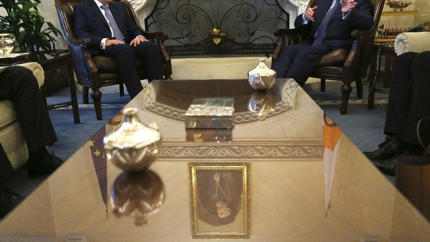 Cyprus' President Nicos Anastasiades, right, Egypt's Petroleum Minister Tarek el-Molla, left, talk during their meeting at the Presidential palace in Nicosia, Cyprus, Wednesday, Aug. 31, 2016. Cyprus and Egypt have signed an agreement paving the way for the supply of Cypriot gas to the Arab nation through an envisioned pipeline. (AP Photo/Petros Karadjias)