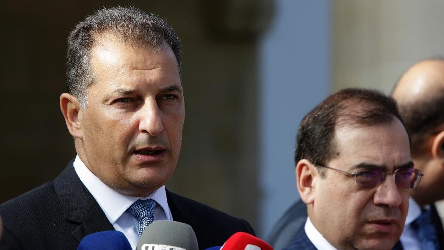 Cyprus' Energy Minister Yiorgos Lakkotrypis, left, and Egypt's Petroleum Minister Tarek el-Molla speak to the media after a meeting with Cyprus' President Nicos Anastasiades at the Presidential palace in Nicosia, Cyprus, Wednesday, Aug. 31, 2016. Cyprus and Egypt have signed an agreement paving the way for the supply of Cypriot gas to the Arab nation through an envisioned pipeline. (AP Photo/Petros Karadjias)