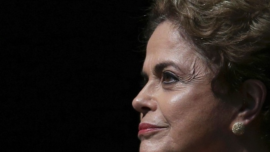 Brazil's President Dilma Rousseff attends the opening of the National Conference of Women, in Brasilia, Brazil, Tuesday, May 10, 2016. The impeachment proceedings against Rousseff took another hairpin turn Tuesday after the acting speaker of Congress' lower house Waldir Maranhao put the impeachment process back on track a day after he sparked chaos and sowed further discord among Brazil's fractious political class by annulling an April 17 vote by the Chamber of Deputies for impeachment. (AP Photo/Eraldo Peres)