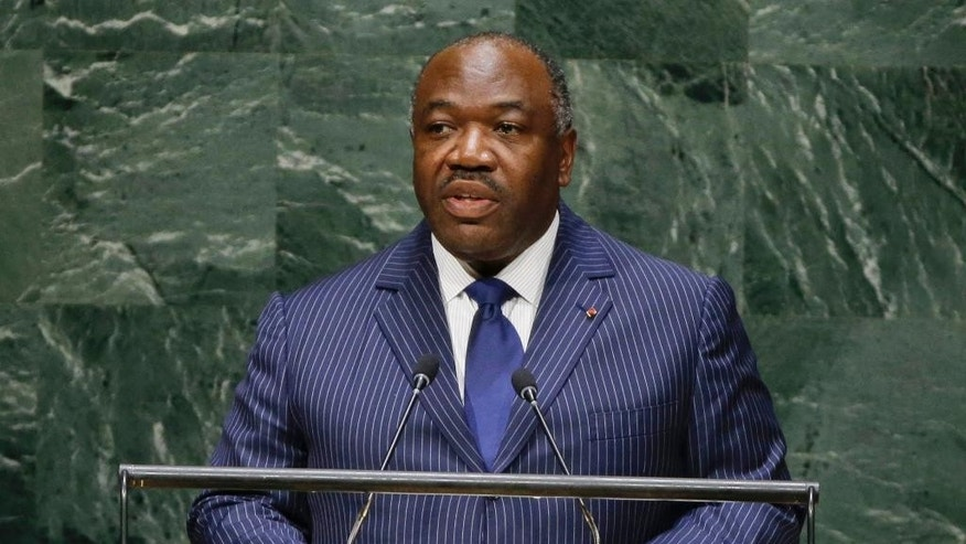 FILE - File photo taken Thursday, Sept. 25, 2014, as Gabon President Ali Bongo Ondimba addresses the 69th session of the United Nations General Assembly at the United Nations headquarters. Gabon's president has narrowly won re-election, election officials said Wednesday Aug. 31, 2016, keeping alive a family dynasty in this oil-rich Central African country that reaches back to the 1960's.  (AP Photo/Frank Franklin II, File)