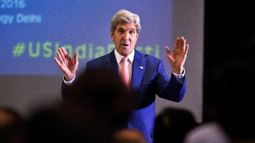 U.S. Secretary of State John Kerry greets students at Indian Institute of Technology (IIT) in New Delhi, India, Wednesday, Aug. 31, 2016. Kerry is on a three-day visit to India. (AP Photo/Saurabh Das)