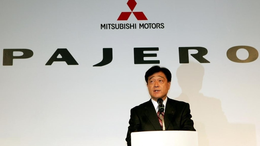 FILE - In this Oct. 4, 2006 file photo, Mitsubishi Motors Corp. President Osamu Masuko smiles as he introduces the fully redesigned Pajero, the Japanese automaker's flagship SUV, at its headquarters in Tokyo.  The mileage scandal at Mitsubishi Motors Corp. is widening after the Japanese government ordered sales halted on eight more models after finding mileage was falsely inflated. The Japanese automaker acknowledged in April, 2016, it systematically falsified mileage data on its eK wagon and eK Space minicars, also produced for Nissan Motor Co.  At that time, it had said no other models were affected. But the transport ministry carried out its own tests and said Tuesday, Aug. 30, 2016,  that it had found other models, including the Pajero sport utility vehicle, had inflated mileage by as much as 8.8 percent, and on average 4.2 percent. (AP Photo/Katsumi Kasahara, File)