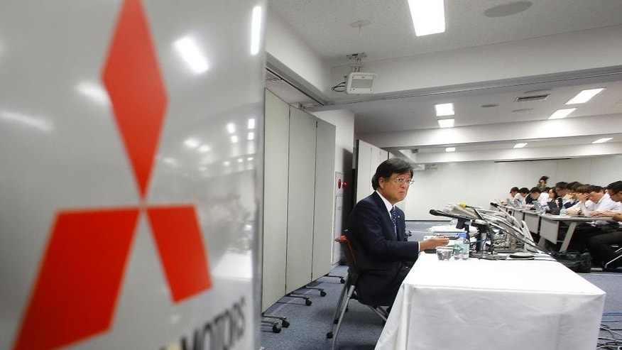 FILE- In this Aug. 2, 2016 file photo, Mitsubishi Motors Corp. Chairman Osamu Masuko attends a press conference at the headquarters of the automaker in Tokyo.  The mileage scandal at Mitsubishi Motors Corp. is widening after the Japanese government ordered sales halted on eight more models after finding mileage was falsely inflated.  The Japanese automaker acknowledged in April,  2016, it systematically falsified mileage data on its eK wagon and eK Space minicars, also produced for Nissan Motor Co. At that time, it had said no other models were affected. But the transport ministry carried out its own tests and said Tuesday, Aug. 30, 2016,  that it had found other models, including the Pajero sport utility vehicle, had inflated mileage by as much as 8.8 percent, and on average 4.2 percent.  (AP Photo/Shizuo Kambayashi, File)