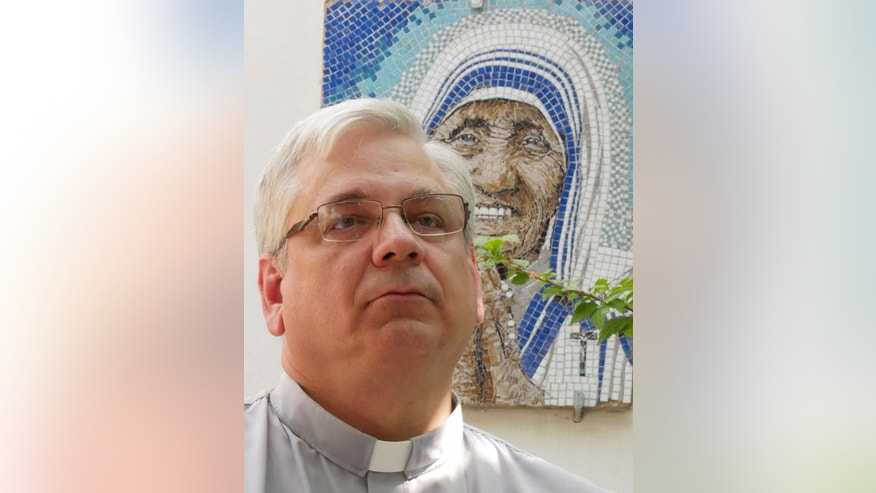 "Rev. Brian Kolodiejchuk, postulator of the cause of beatification and canonization of Mother Teresa, is interviewed by the Associated Press in front of a mosaic picturing Mother Teresa, at the formation house of the priestly branch of the Missionaries of Charity on the outskirts of Rome, Friday, Aug. 18, 2016. When Pope Francis canonizes Mother Teresa on Sunday, Sept. 4, 2016, he'll be honoring a nun who won admirers around the world and a Nobel Peace Prize for her joy-filled dedication to the ""poorest of the poor."" (AP Photo/Giulia Sabella)"