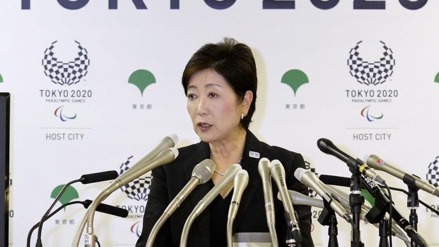 Tokyo Gov. Yuriko Koike speaks during a press conference in Tokyo, Wednesday, Aug. 31, 2016.  A newly elected leader of Tokyo has postponed a plan to relocate the world's biggest fish market, one of the city's most famous landmarks.  Gov. Koike announced Wednesday that she would decide on a date only after an environmental assessment of the new site is completed in January. The move had been scheduled to take place in early November.  (Kyodo News via AP)