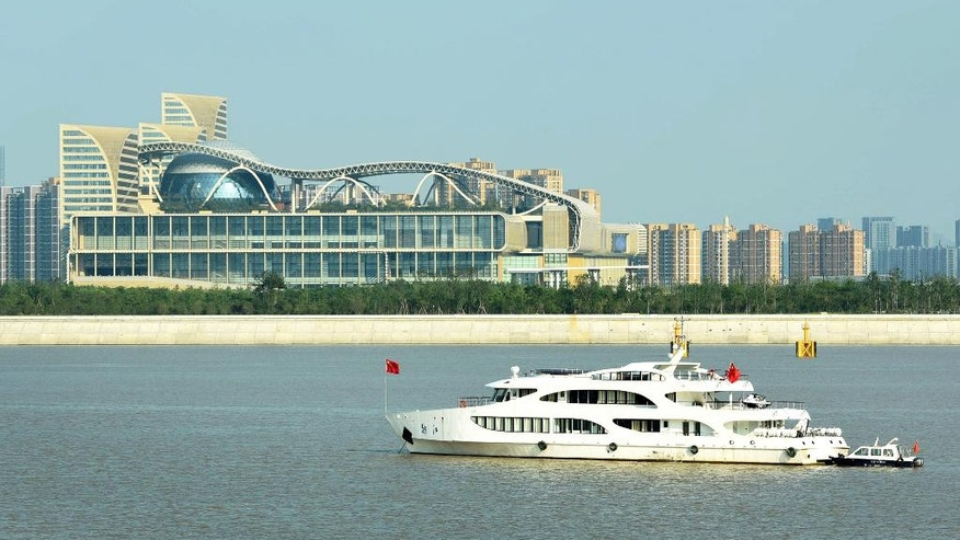 In this Aug. 18, 2016 photo, Chinese police ship patrol near the main venue which will hold the up-coming G20 summit in Hangzhou in east China's Zhejiang province. While the global economy will dominate at this weekend's summit of the Group of 20 industrialized and emerging-market nations, politics and security issues form the backdrop to the gathering of world leaders in the eastern Chinese city of Hangzhou. (Chinatopix via AP)