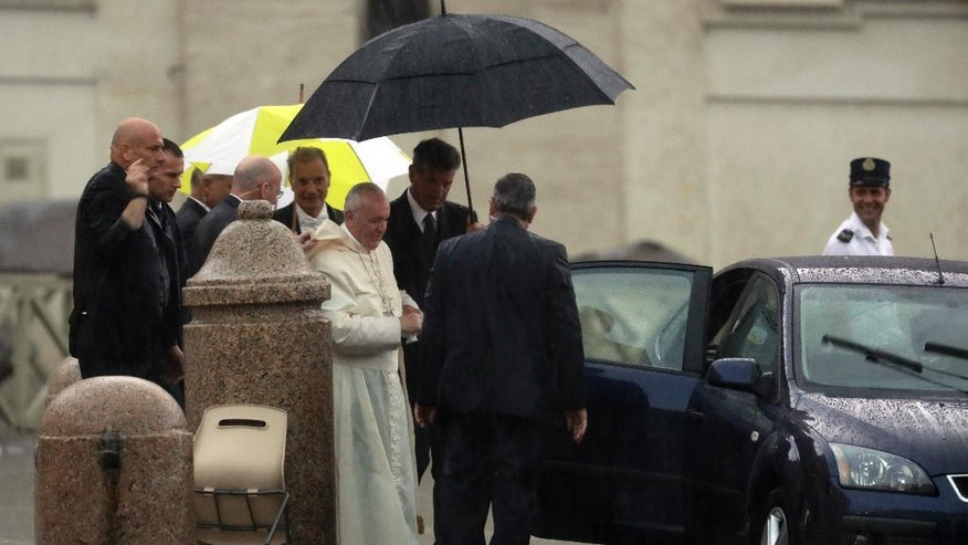 Pope Francis leaves St.Peter's Square, at the Vatican, at the end of his general audience, Wednesday, Aug. 31, 2016. The pontiff had to interrupt his final greetings and leave in a closed car as a sudden rain storm hit the Vatican. (AP Photo/Andrew Medichini)