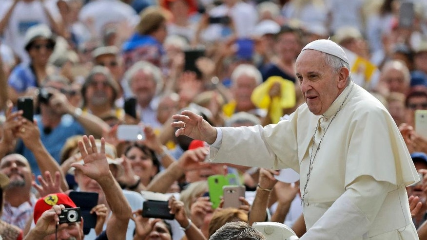 Pope Francis waves to faithful as he is driven through the crowd ahead of his weekly general audience, in St. Peter's Square, at the Vatican, Wednesday, Aug. 31, 2016. (AP Photo/Andrew Medichini)