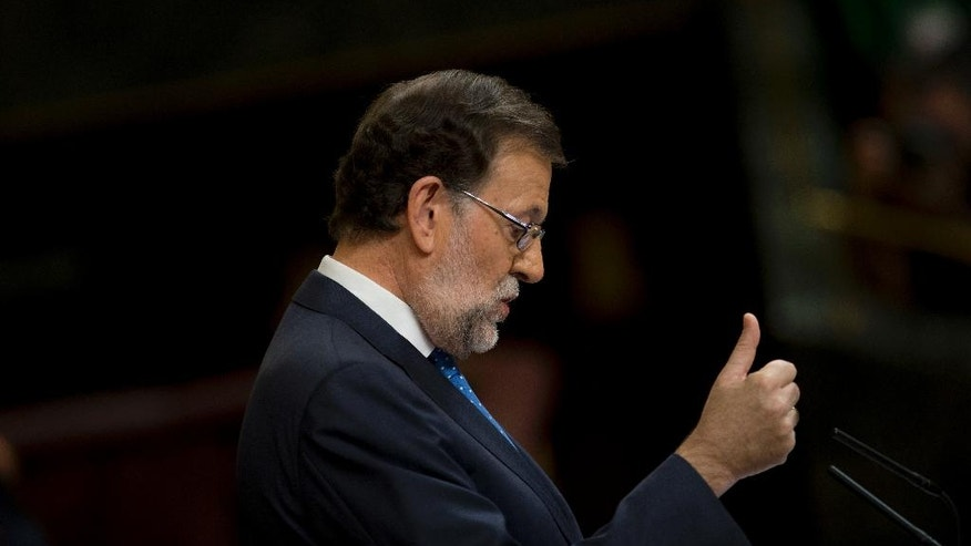 Spain's acting Prime Minister and Popular Party leader Mariano Rajoy addresses lawmakers during the first of the two-day investiture debate at the Spanish parliament in Madrid, Tuesday, Aug. 30, 2016. Rajoy started a two-day parliamentary debate later Tuesday ahead of a vote on his bid to form a minority government and end an eight-month political impasse, but the signs are he won't be successful. (AP Photo/Francisco Seco)