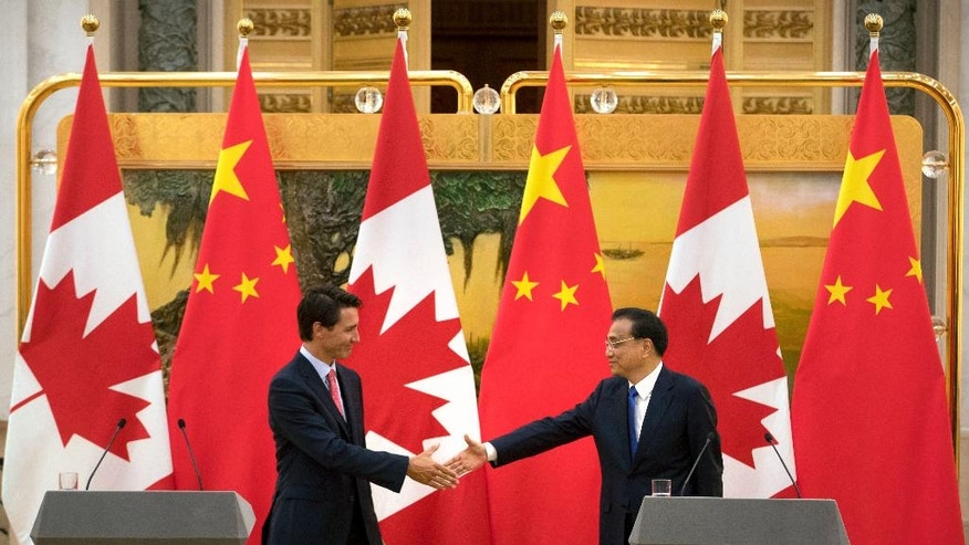 Canada's Prime Minister Justin Trudeau, left, and China's Premier Li Keqiang, right, shake hands at the end of a joint press conference at the Great Hall of the People in Beijing, Wednesday, Aug. 31, 2016. (AP Photo/Mark Schiefelbein)