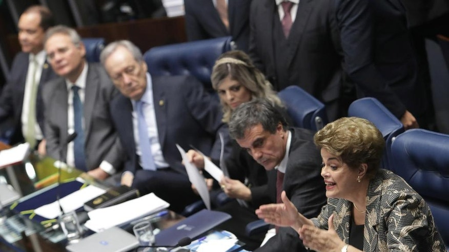 "Brazil's suspended President Dilma Rousseff speaks at her own impeachment trial, in Brasilia, Brazil, Monday, Aug. 29, 2016. Fighting to save her job, Rousseff told senators on Monday that the allegations against her have no merit. ""I know I will be judged, but my conscience is clear. I did not commit a crime,"" she told senators. Rousseff's address comes on the fourth day of the trial. (AP Photo/Eraldo Peres)"