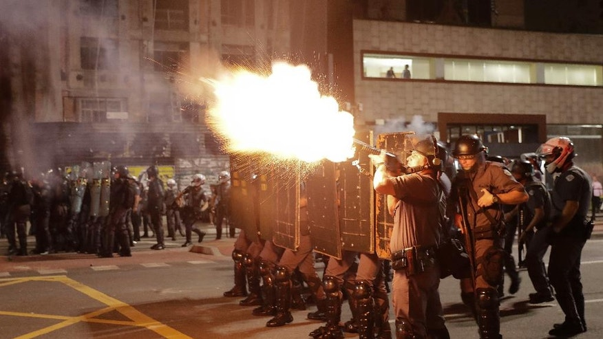 Police fire tear gas against supporters of Brazil's suspended President Dilma Rousseff during a rally in Sao Paulo, Brazil, Monday, Aug. 29, 2016. Fighting to save her job, Rousseff appeared before congress for her impeachment trial, to defend herself as her accusers say she hurt the economy with budget manipulations. (AP Photo/Andre Penner)
