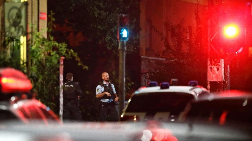Danish police officers stand on patrol near Christiania in Copenhagen late night Wednesday, Aug. 31, 2016.  Police say they have shot and critically wounded an armed Danish man following an earlier Copenhagen shootout that left two officers and a bystander wounded. (Jens Dresling/POLFOTO via AP)  DENMARK OUT