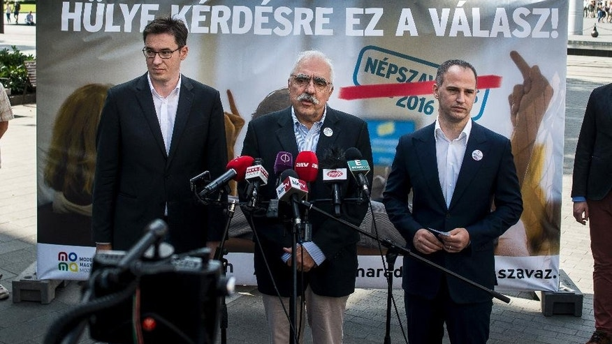 Leaders of three opposition parties Gergely Karcsony, co-president of the Dialogue for Hungary, Lajos Bokros, President of The Modern Hungary Movement and Viktor Szigetvari, leader of the Together party, left to right, present their joint billboard campaign during their press conference Budapest, Hungary, Thursday, Sept. 1, 2016. The three small opposition parties are calling for a boycott of the government-sponsored referendum seeking support against any future European Union plans to resettle refugees among member countries. (Janos Marjai/MTI via AP)