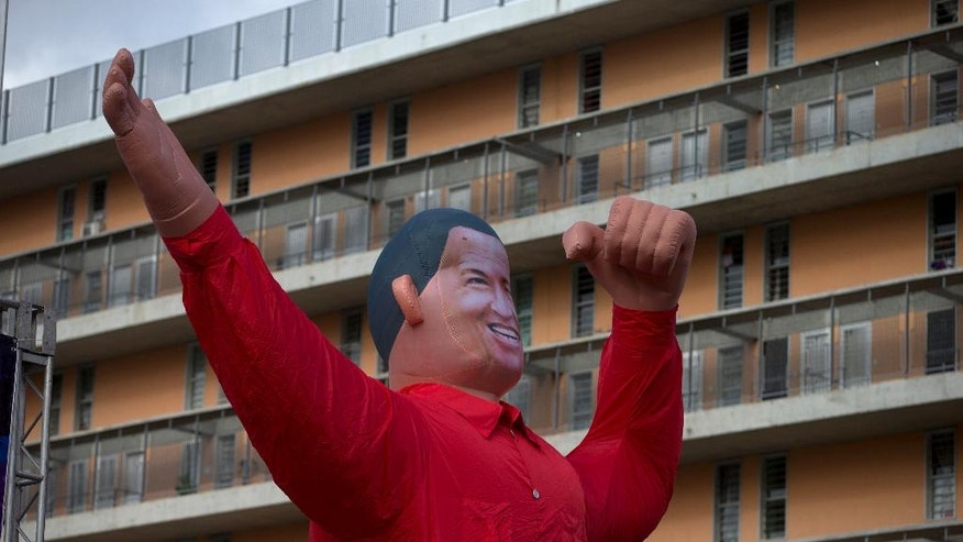 "A giant inflatable depicting Venezuela's late President Hugo Chavez towers over Bolivar Avenue during a rally in support of Venezuela's President Nicolas Maduro in Caracas, Venezuela, Thursday, Sept. 1, 2016. Opponents of Maduro promise to flood the streets of Caracas Thursday in a major test of their strength and the government's ability to tolerate growing dissent. The march called the ""taking of Caracas"" aims to pressure electoral authorities to allow a recall referendum against Maduro this year. (AP Photo/Fernando Llano)"
