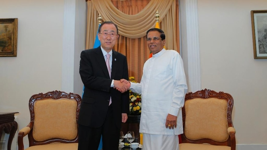 Sri Lankan president Maithripala Sirisena, right, poses with U.N. Secretary General Ban Ki-moon during their meeting in Colombo, Sri Lanka, Thursday, Sept. 1, 2016. Ban began the visit to Sri Lanka on Wednesday during which he is expected to discuss post-civil war reconciliation and human rights accountability with the country's leaders. (AP Photo/Eranga Jayawardena)