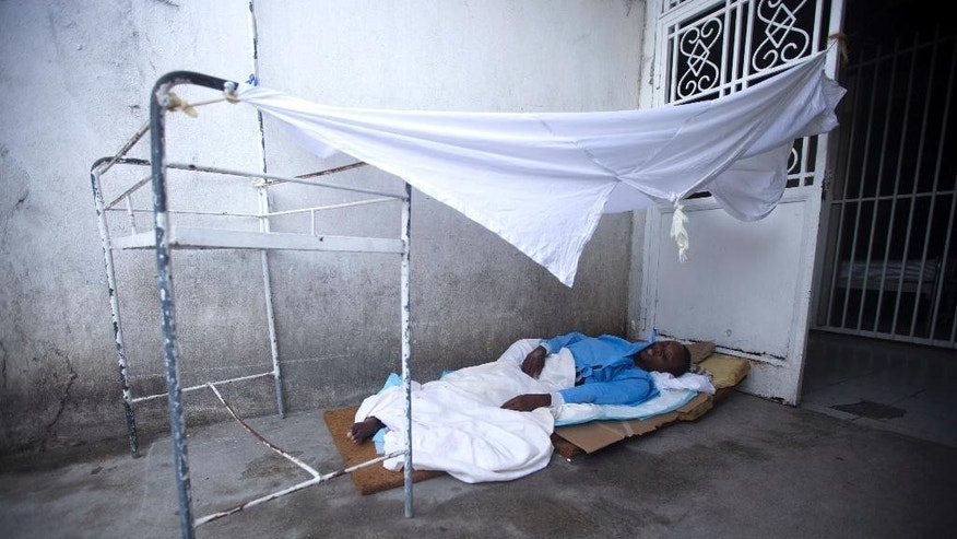 Viellard Ylfauker lies down outside the emergency room as he waits for treatment at the State University Hospital of Haiti, in Port-au-Prince, Haiti, Thursday, Sept. 1, 2016. Haiti's lengthiest and most punishing strike by young doctors and other medical workers has come to an end. Resident doctors at Port-au-Prince's General Hospital first walked off the job in March. Nurses and support staff followed. Waves of strikes then spread to 12 other government-run hospitals across Haiti. ( AP Photo/Dieu Nalio Chery)
