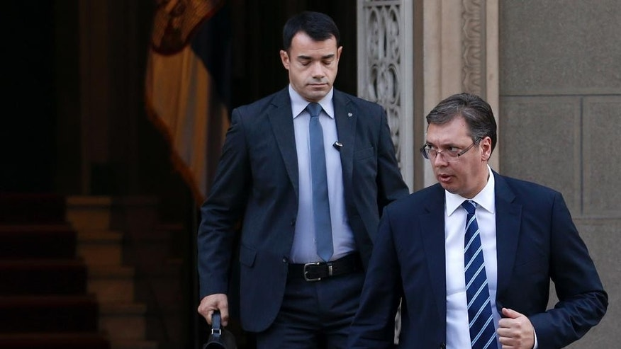 Serbian Prime Minister Aleksandar Vucic, right, leaves the Serbian presidency building after a meeting with Serbian President Tomislav Nikolic and Bosnian Serb leaders in Belgrade, Serbia, Thursday, Sept. 1, 2016. Serbia says it will not try to persuade the Bosnian Serbs to cancel a disputed referendum that has challenged the international community in Bosnia and fueled ethnic tensions more than twenty years after the 1992-95 war. (AP Photo/Darko Vojinovic)