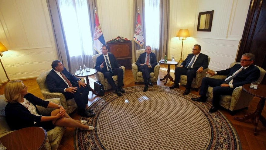 Serbian Prime Minister Aleksandar Vucic, third from left, speaks during a meeting with Serbian President Tomislav Nikolic, third from right, and Bosnian Serb leaders: Prime Minister of Republika Srpska Zeljka Cvijanovic, left, President of Republika Srpska Milorad Dodik, second from left, Serb Democratic Party leader Mladen Bosnic, right, and member of the Presidency of Bosnia and Herzegovina Mladen Ivanic, second from right, in Belgrade, Serbia, Thursday, Sept. 1, 2016. Serbia says it will not try to persuade the Bosnian Serbs to cancel a disputed referendum that has challenged the international community in Bosnia and fueled ethnic tensions more than twenty years after the 1992-95 war. (AP Photo/Darko Vojinovic)