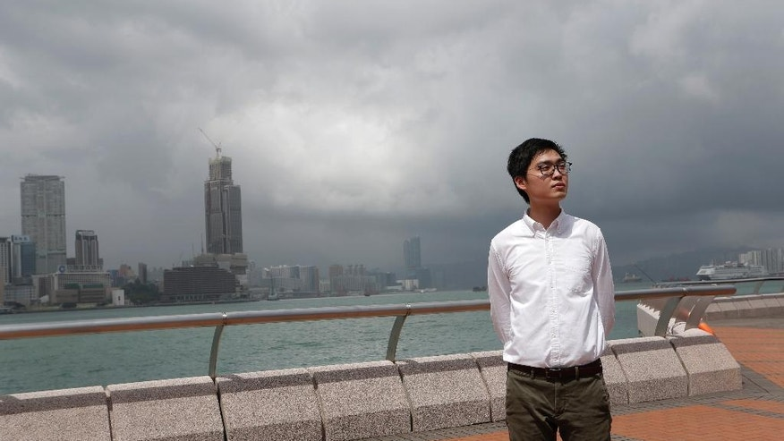 In this Friday, Aug. 19, 2016, photo, Andy Chan Ho-tin of the Hong Kong Nationalist Party poses during an interview in Hong Kong. Two years after the end of chaotic pro-democracy protests in Hong Kong, a number of young activists who were politically awakened by the movement hope to keep its spirit alive by running for political office on Sunday, Sept. 4, 2016. (AP Photo/Vincent Yu)