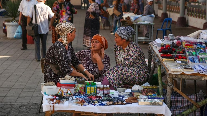 Street vendors talk at a market in Tashkent, Uzbekistan, Wednesday, Aug. 31, 2016. Uzbekistan's prime minister led the nation's Independence Day celebration Wednesday in the capital of Tashkent as President Islam Karimov remained hospitalized. (AP Photo)