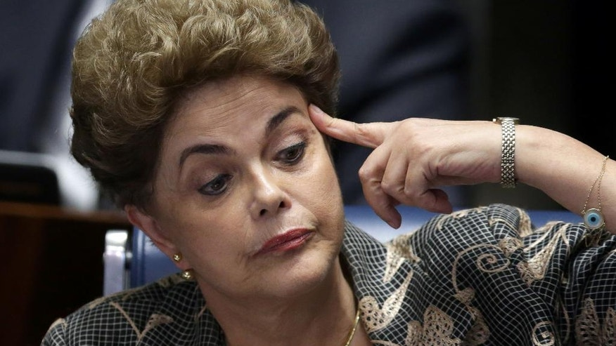 In this Aug. 29, 2016 photo, suspended Brazilian President Dilma Rousseff reacts during her impeachment trial at the Federal Senate in Brasilia, Brazil. Rousseff's scheduled appearance during her impeachment trial is the culmination of a fight going back to late last year, when opponents in Congress presented a measure seeking to remove her from office. Rousseff was eventually ousted and her vice president and rival Michel Temer was sworn in. (AP Photo/Eraldo Peres)