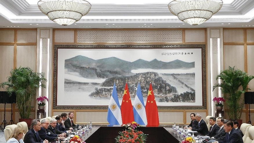 Chinese President Xi Jinping, right, and Argentina's President Mauricio Macri, second left, during their meeting at the West Lake State Guest House in Hangzhou, China Saturday, Sept. 3, 2016. (Lintao Zhang/Pool Photo via AP)