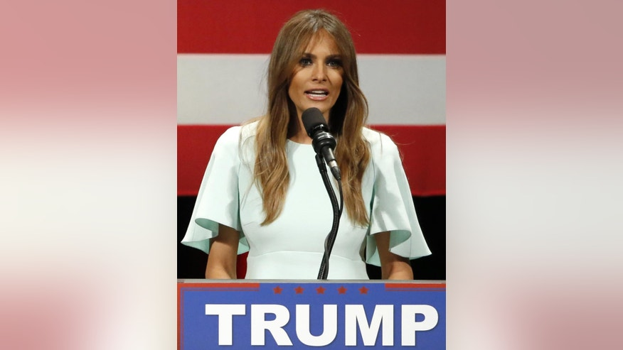 FILE _ This is a April 4, 2016,  file photo,  of Melania Trump, wife of Republican presidential candidate Donald Trump  as she addresses the crowd during a rally at the Milwaukee Theatre in Milwaukee. The Daily Mail newspaper Friday Sept. 2, 2016 has retracted a story about Melania Trump after her lawyers filed a lawsuit in the United States accusing the newspaper and a Maryland blogger of publishing false statements about her alleged involvement with an escort agency. (AP Photo/Charles Rex Arbogast, File)