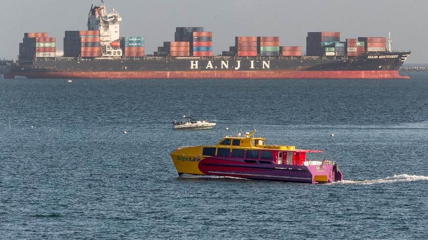 South Korea's Hanjin Shipping Co. container ship Hanjin Montevideo, top, is anchored outside the Port of Long Beach in Long Beach, Calif., on Thursday, Sept. 1, 2016. The bankruptcy of the Hanjin shipping line has thrown ports and retailers around the world into confusion, with giant container ships marooned and merchants worrying whether tons of goods will reach their shelves. The South Korean giant filed for bankruptcy protection on Wednesday, Aug. 31, and stopped accepting new cargo.  (AP Photo/Damian Dovarganes)