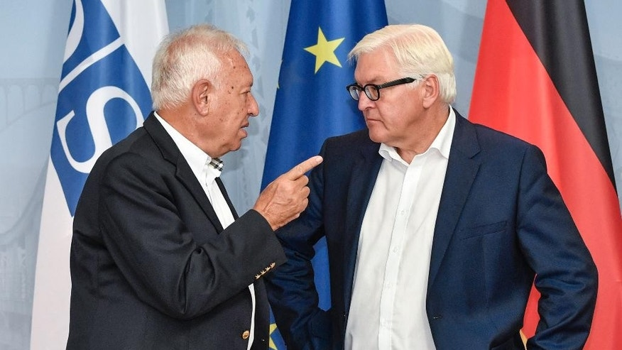 Spain's Foreign Minister Jose Manuel Garcia-Margallo, left, talks to German Foreign Minister Frank-Walter Steinmeier during the Informal OSCE Foreign Minister's Meeting in Potsdam, Thursday, Sept. 1, 2016. (John MacDougall/Pool Photo via AP)