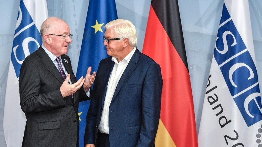 Ireland's Foreign Minister Charles Flanagan, left, is greeted by German Foreign Minister Frank-Walter Steinmeier during the Informal OSCE Foreign Minister's Meeting in Potsdam, Germany, Thursday, Sept. 1, 2016. (John MacDougall/Pool Photo via AP)