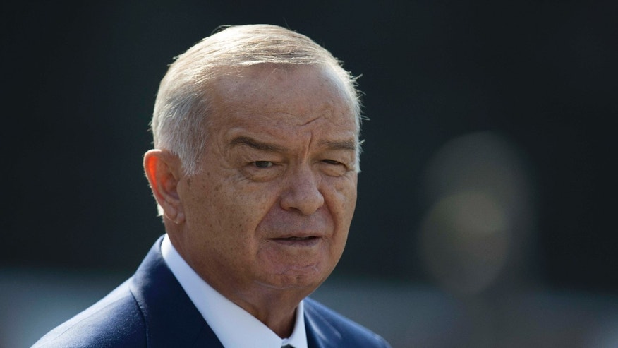 FILE - In this Monday, April 15, 2013 file photo, Uzbek President Islam Karimov leaves a wreath laying ceremony at the Tomb of Unknown Soldier in Moscow, Russia.