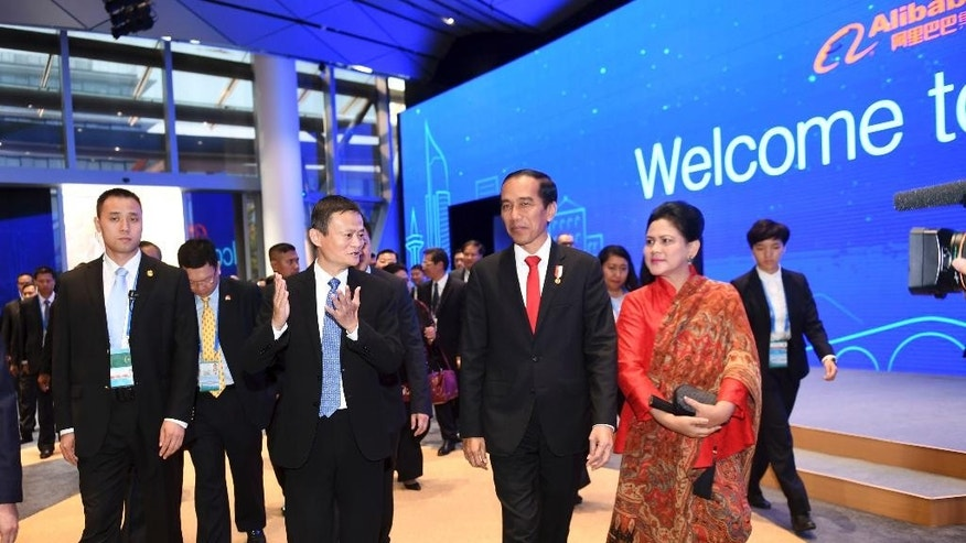 In this photo released by Xinhua News Agency, Jack Ma, center left, founder of China's e-commerce giant Alibaba, introduces the enterprise to visiting Indonesian President Joko Widodo at the headquarters of Alibaba Group in Yuhang District of Hangzhou in eastern China's Zhejiang Province, Sept. 2, 2016. Widodo is in Hangzhou to attend the G20 summit. (Liangkuai/Xinhua via AP)