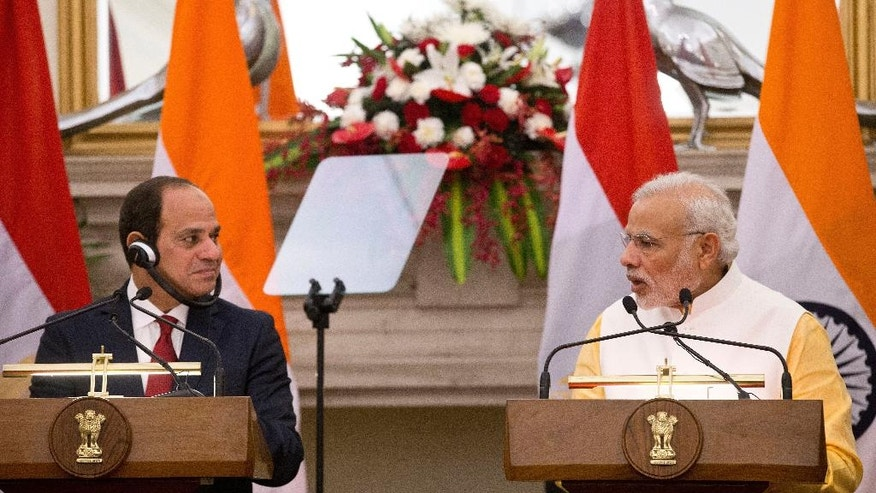 Egyptian President Abdel-Fattah el-Sissi, left, and Indian Prime Minister Narendra Modi look at each other during a joint press briefing after their meeting in New Delhi, India, Friday, Sept. 2, 2016. El-Sissi is on a three-day official visit to India. (AP Photo/Saurabh Das)