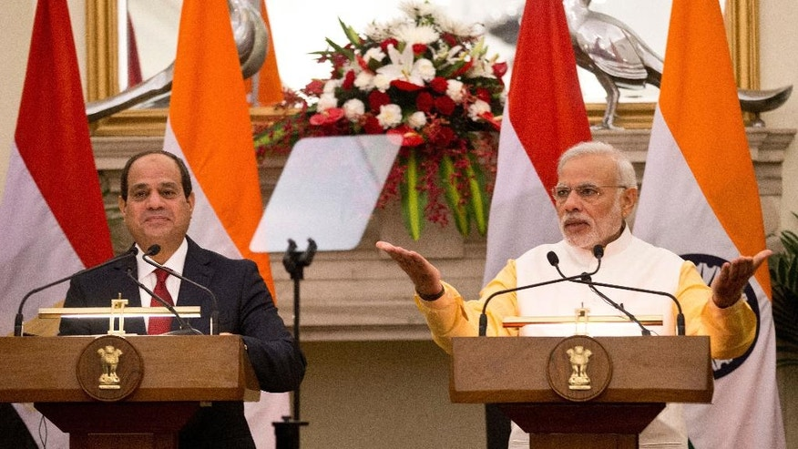 Egyptian President Abdel-Fattah el-Sissi, left, listens to Indian Prime Minister Narendra Modi  speaking during a joint press briefing after their meeting in New Delhi, India, Friday, Sept. 2, 2016. El-Sissi is on a three-day official visit to India. (AP Photo/Saurabh Das)