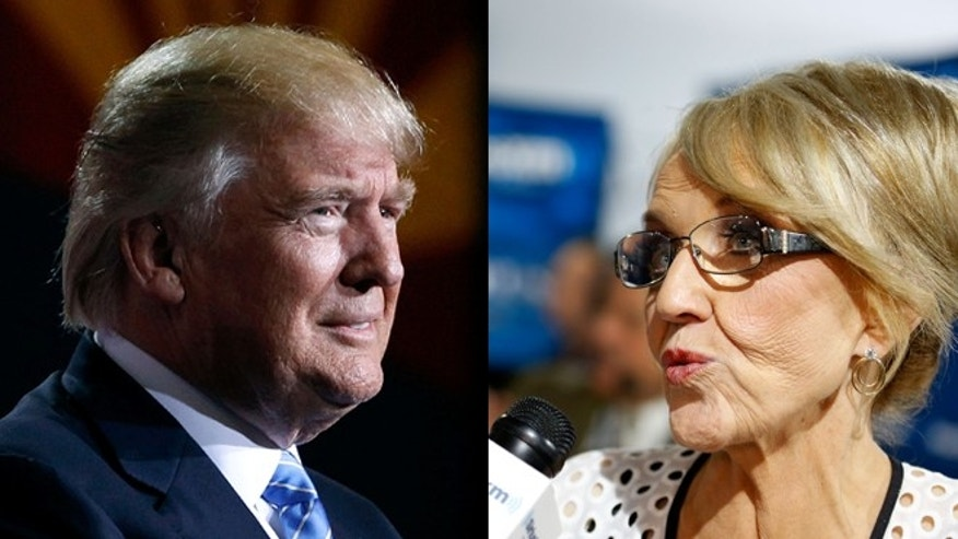 Donald Trump, left, and former Arizona Gov. Jan Brewer. (Photo: Getty Images)