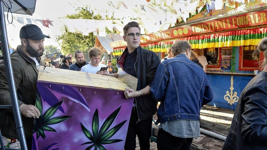 Residents of Christiania, remove the illegal hashish stalls in Pusher Street, Copenhagen on Friday, Sept 2, 2016. Residents of Copenhagen's semi-autonomous Christiania neighborhood are tearing down the hashish market in the hippie colony after an alleged drug dealer shot two police officers and a bystander. The 25-year-old gunman escaped after the attack but was arrested after a shoot-out with police and authorities and his defense lawyer said Friday that he had died from his wounds. (Thomas Borberg/ AP via POLFOTO)