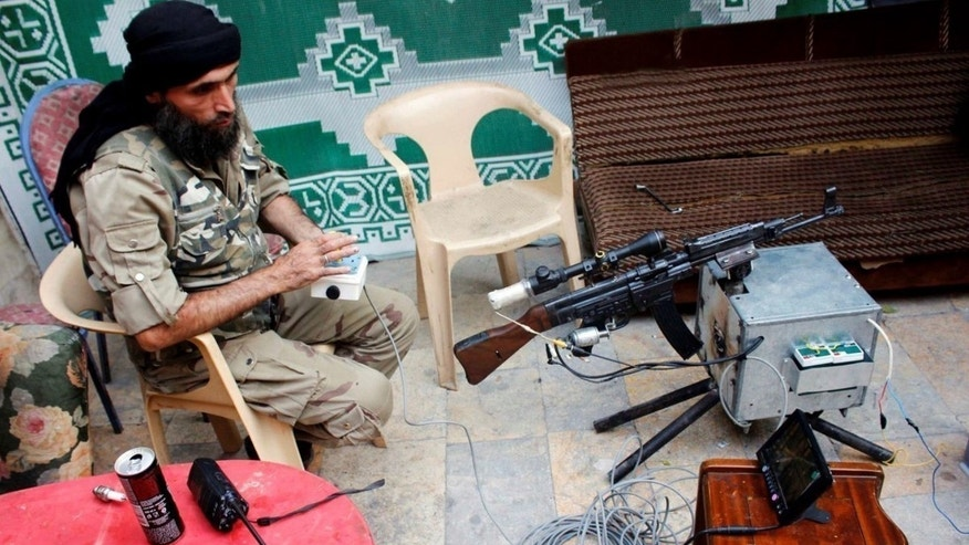 A Free Syrian Army rebel is seen with a remotely-operated StG-44.