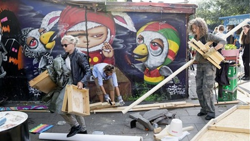 Residents of Christiania remove the illegal hashish stalls in Pusher Street, Copenhagen on Friday, Sept 2, 2016. (Thomas Borberg/ AP via POLFOTO)
