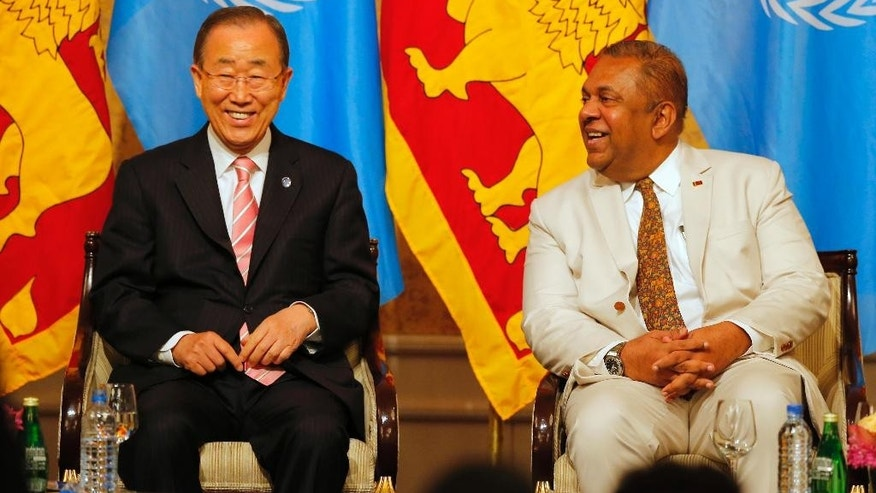 U.N. Secretary-General Ban Ki-moon, left, shares a light moment with Sri Lankan Foreign Minister Mangala Samaraweera before delivering a speech on sustainable development to civil society partners during his visit in Colombo, Sri Lanka, Friday, Sept. 2, 2016. (AP Photo/Eranga Jayawardena)