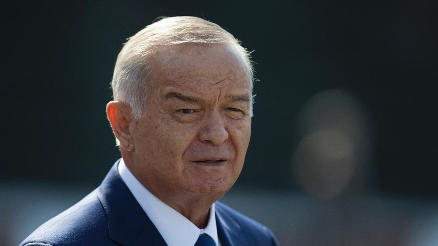 FILE - In this Monday, April 15, 2013 file photo, Uzbek President Islam Karimov leaves a wreath laying ceremony at the Tomb of Unknown Soldier in Moscow, Russia. A national newsreader has delivered a televised Independence Day speech on behalf of ailing President Islam Karimov, who remains hospitalized in the Uzbek capital, Tashkent, with a suspected brain hemorrhage. (AP Photo/Alexander Zemlianichenko, file)