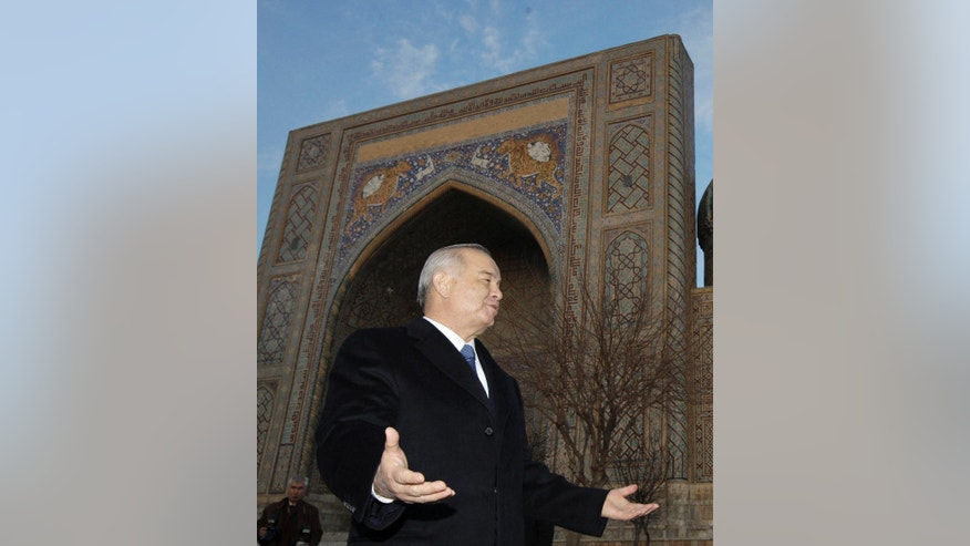 FILE - In this Thursday, Jan. 1, 2016 file photo, Uzbekistan's President Islam Karimov speaks to Russian Prime Minister Dmitry Medvedev while touring the ancient city of Samarkand in central Uzbekistan. A national newsreader has delivered a televised Independence Day speech on behalf of ailing President Islam Karimov, who remains hospitalized in the Uzbek capital, Tashkent, with a suspected brain hemorrhage. (Dmitry Astakhov, Sputnik, Government Pool Photo via AP, file)