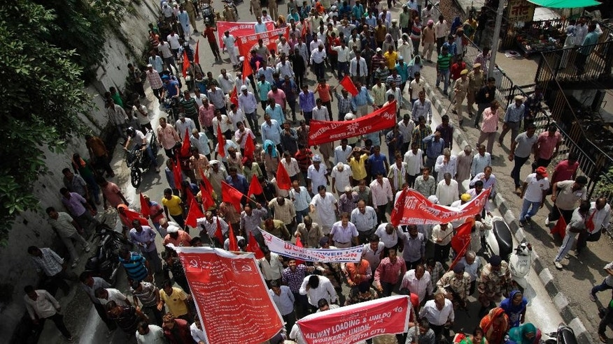 Indian workers participate in a rally during a nationwide strike called by trade unions, in Jammu, India, Sept. 2, 2016.The strike has been called against the government's alleged anti labor policies. Activists also demanded higher minimum wages and provision of social security for workers from unorganized sectors. (AP Photo/Channi Anand)