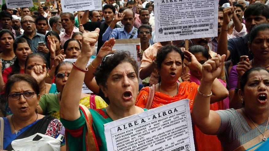 Indian government and bank employees shout slogans as they participates in a protest during a nationwide strike called by trade unions in Mumbai, India, Friday, Sept. 02, 2016. The strike has been called against the government's alleged anti labor policies. Activists also demanded higher minimum wages and provision of social security for workers from unorganized sectors. (AP Photo/Rajanish Kakade)